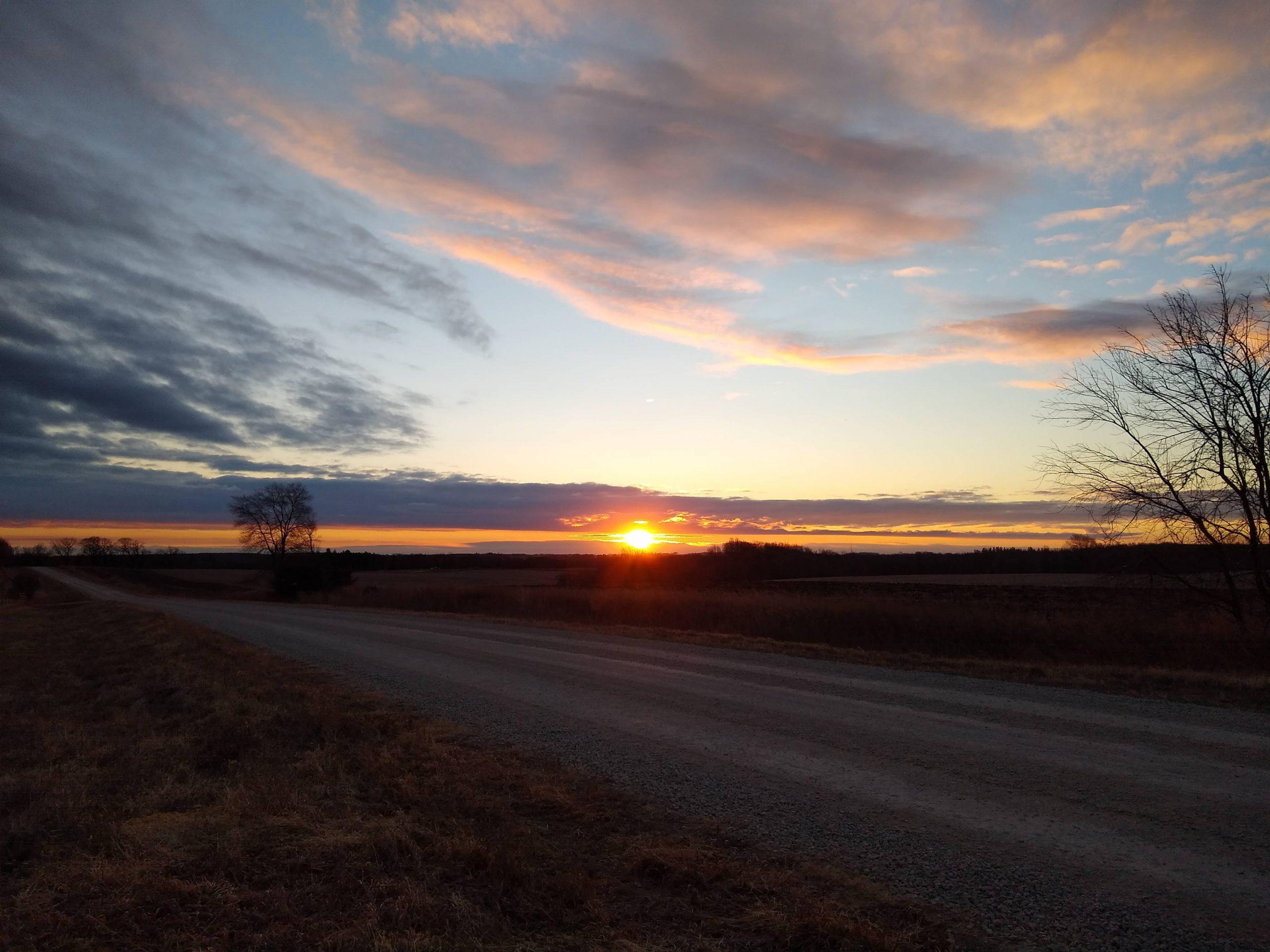 Solstice sunrise above Root River Park